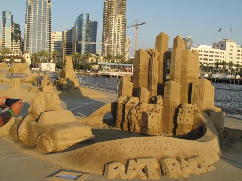 U.S. Sand Sculpting Challenge - Rat Race - We Honor The Worker This Labor Day